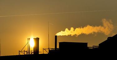 Pictured: A smoking factory in front of the sun in Cleveland Ohio.