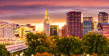 Pictured: A cityscape of downtown Hartford during a sunset.
