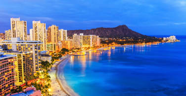 Pictured: A coastline view of the city of Honolulu at night.