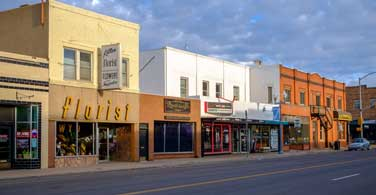 Pictured: Commercial buildings along a street in downtown Laramie Wyoming.