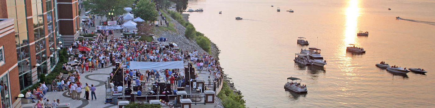 This is an image of a crowd gathering at a festival along the waterfront of Owensboro. ASTA-USA provides professional translation services in this city.