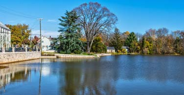 Pictured: A view of a historic building on a pond in Allentown Pennsylvania.