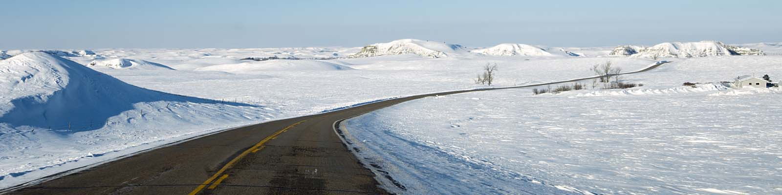 This is an image of a road surrounded by snow in Bismark North Dakota where ASTA-USA provides professional translation services.