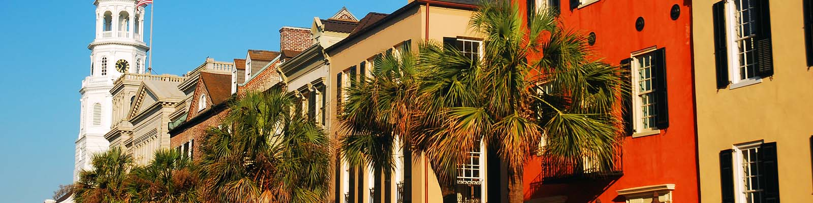 This is an image of colored buildings in downtown Charleston South Carolina where ASTA-USA provides professional translation services.