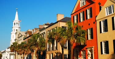 Pictured: Colored buildings on Rainbow Row in Charleston South Carolina.