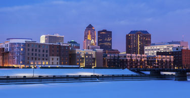 Pictured: A cityscape of Des Moines Iowa at night.