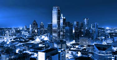 Pictured: A view of downtown Dallas Texas at night.