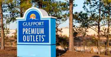 Pictured: The GulfPort Premium Outlets sign in Gulfport Mississippi.