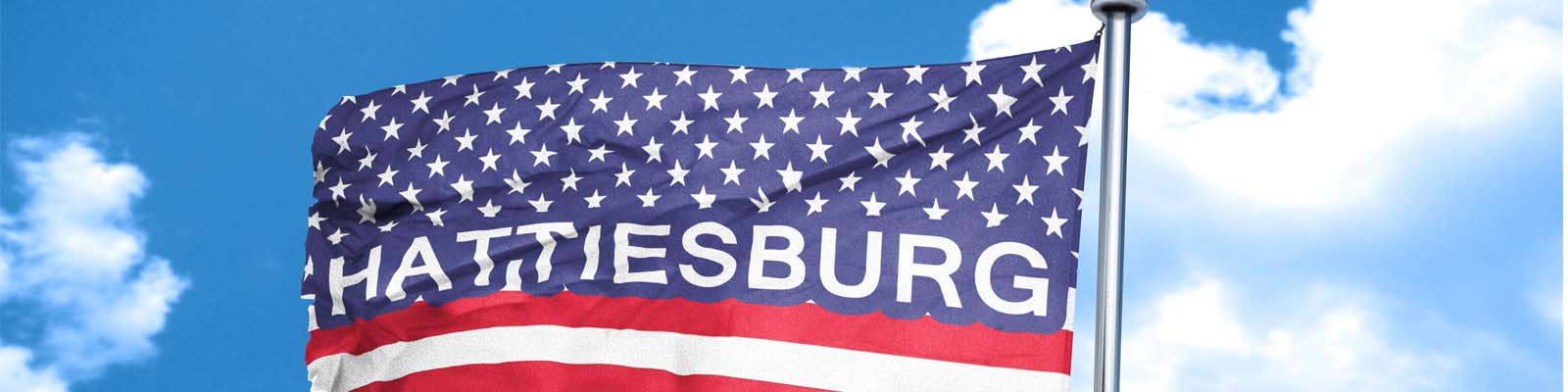 This is an image of the American flag with the word Hattiesburg in Hattiesburg Mississippi where ASTA-USA provides professional translation services.