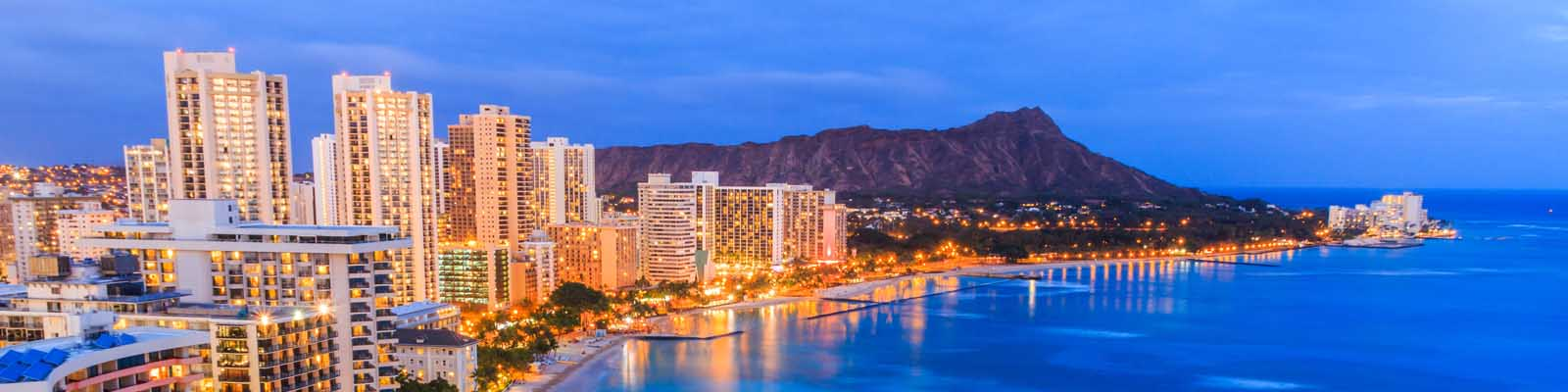 This is a coastal skyline of Honolulu at night. ASTA-USA provides professional translation services in this city.