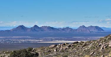 Pictured: A valley and distant mountains.