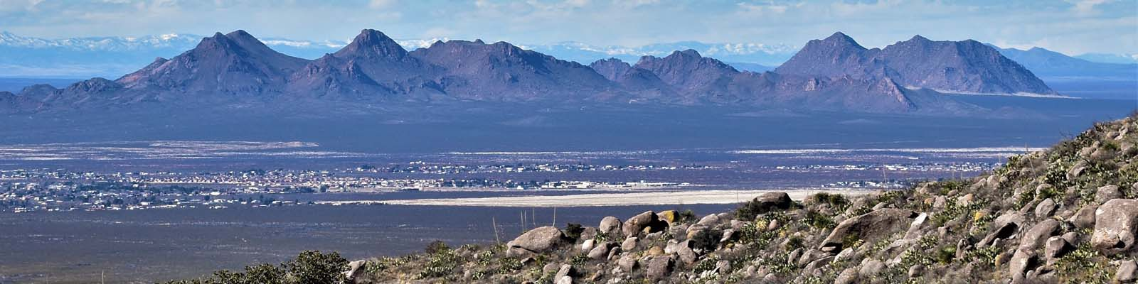 This is an image of a wide valley between mountains in Las Cruces. ASTA-USA provides professional translation services in this city.