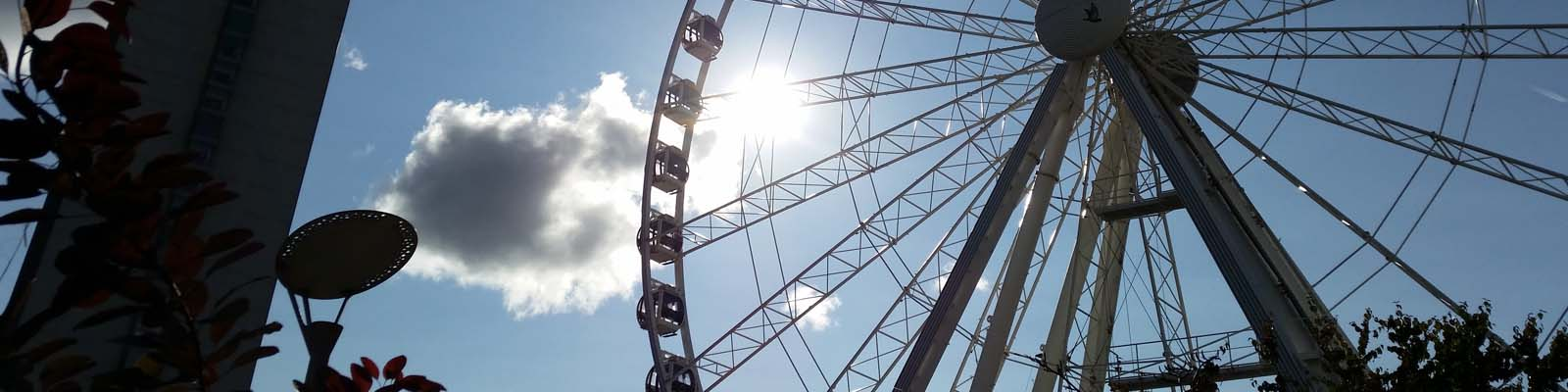 This is an image of a large ferris wheel in Manchester. ASTA-USA provides professional translation services in this city.