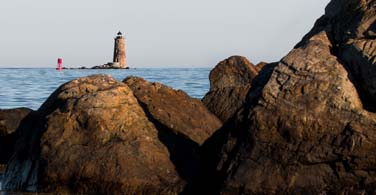 Pictured: The coast and a lighthouse in New Hampshire.