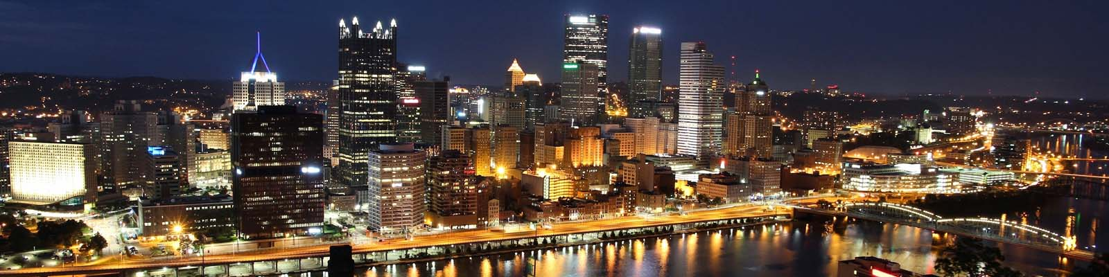 This is a skyline of downtown Pittsburgh at night. ASTA-USA offers professional translation services here.