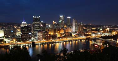 Pictured: A nighttime skyline of Pittsburgh Pennsylvania.