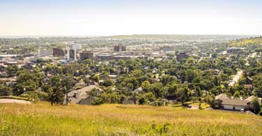 Pictured: A daytime cityscape of Rapid City South Dakota.