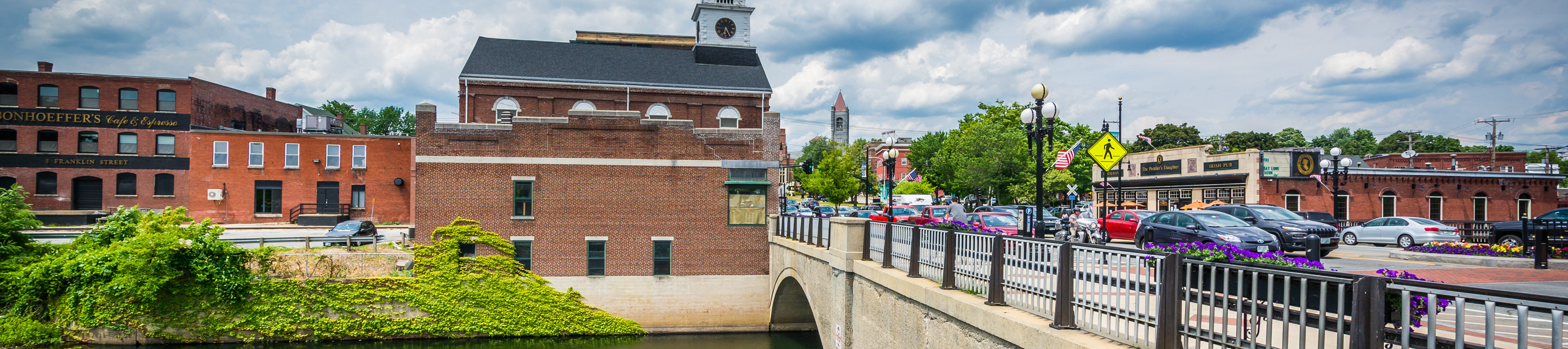 This is an image of a bridge and dowtown Nashua. ASTA-USA provides professional translation services in this city.
