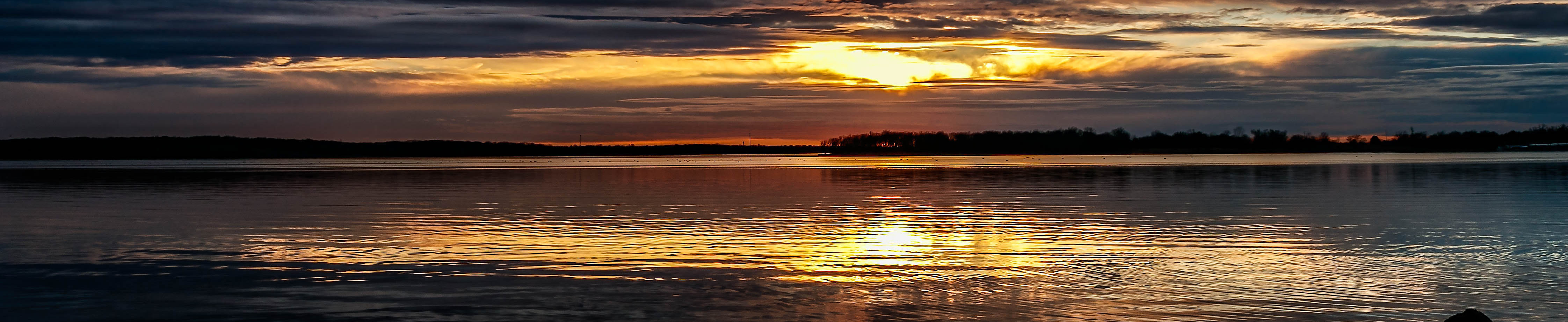 This is an image of a sunset view over a lake in Broken Arrow Oklahoma where ASTA-USA provides professional translation services.