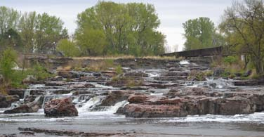Pictured: River water running down rocks in Sioux Falls South Dakota.
