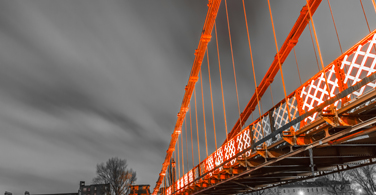 Pictured: A bridge and dark sky in South Portland Maine.